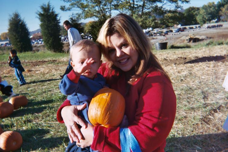 Tony with his mommy he picked the perfect pumkin